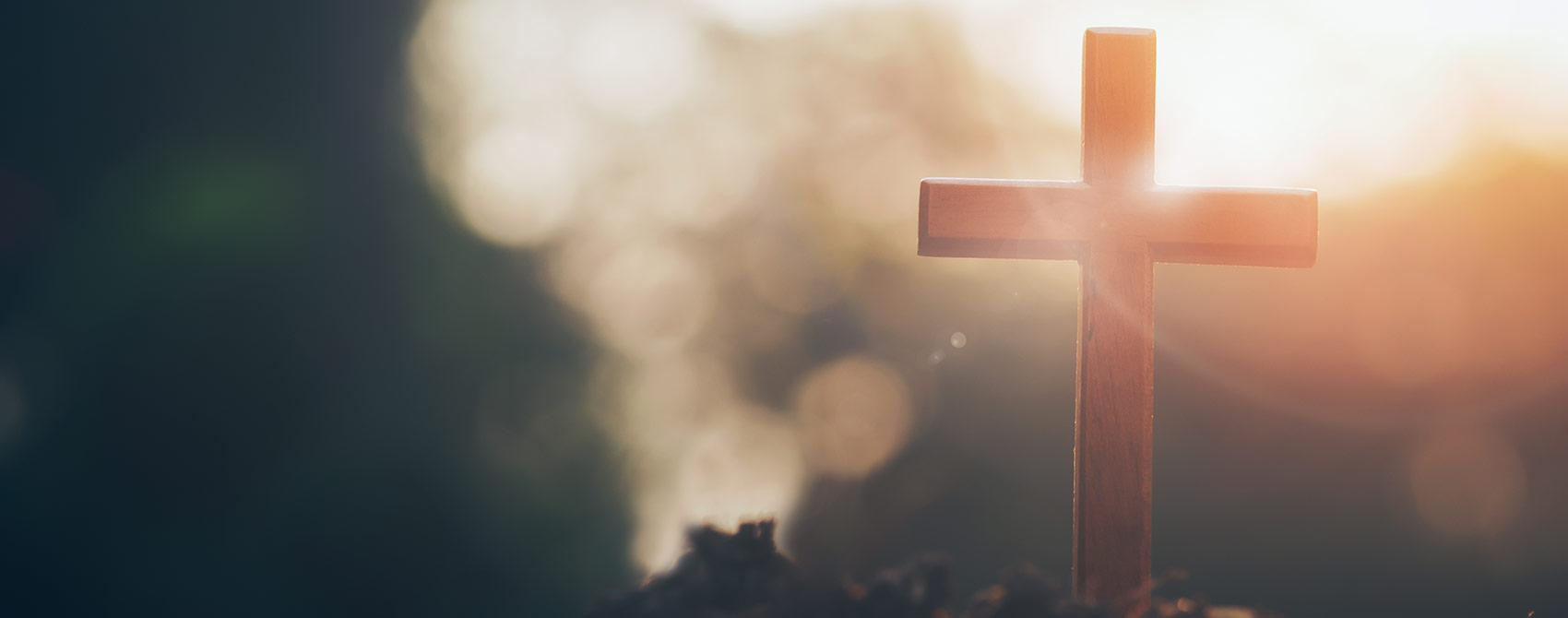A photo of a wooden cross representing Christian ministry.