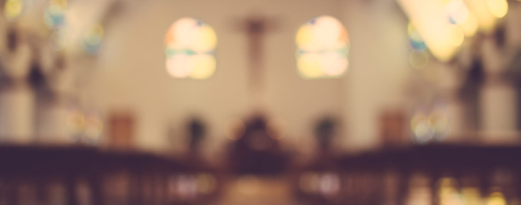 A Christian church interior out of focus.