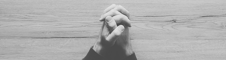 Clasped hands praying.